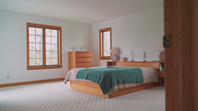 bedroom in the interior modern house with luxury classic interior. camera moving backward, exiting the room - moquette video stock e b–roll
