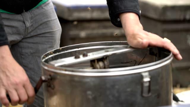 bee farmer extract honey from the bee box - apicoltura video stock e b–roll