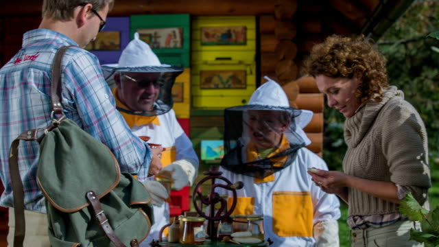 Bee keeper gives the man honey for testing