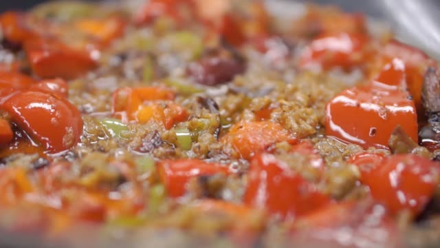 Beef fajitas and bell peppers. Clip. Mexican beef fajitas in iron skillet. Close - up of cooking fajitas in a pan video