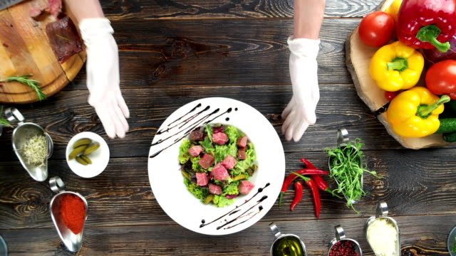 beef salad on wooden background. - lattuga video stock e b–roll
