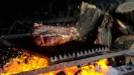 istock Beef steak is cooked on grill with sparks. Beef Rib BBQ 1210640477