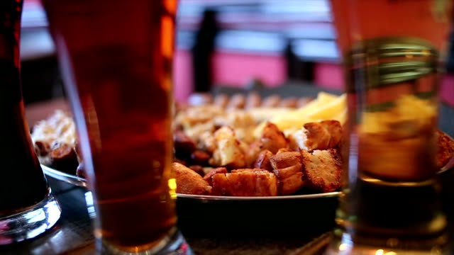 Beer and Antipasto Glasses with Beer and snacks Antipasto: ham, dried sausages, dry bread, pork and french fries. jerky stock videos & royalty-free footage