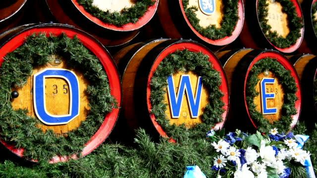 pan beer barrels on oktoberfest close-up (4k/uhd to hd) - oktoberfest stock videos and b-roll footage