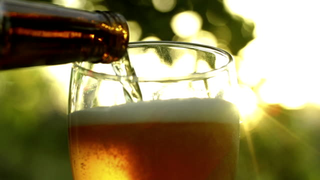 Beer being poured into glass video