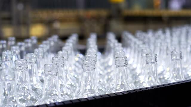 beer bottle factory. conveyor belt. close up - coperchio video stock e b–roll