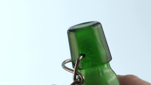 Beer bottle opening close-up video