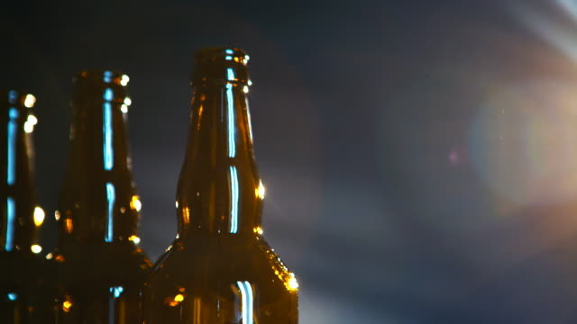 Beer bottles on a dark background video
