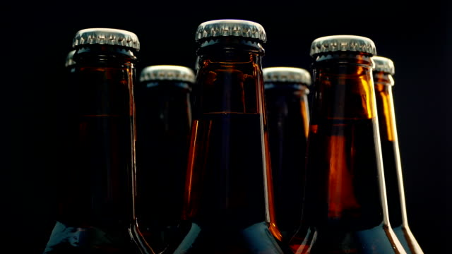 Beer Bottles Rotating On Black Background video