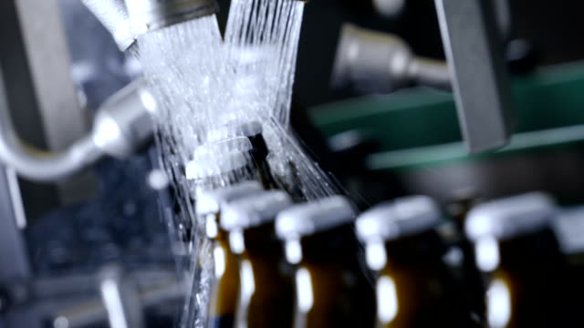 Beer Bottling Line, Cleaning bottles in Slow Motion - video