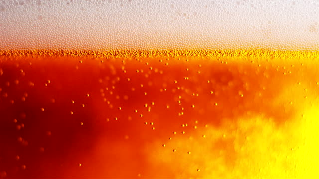 Beer Bubbles And Foam Closeup. Slow Motion