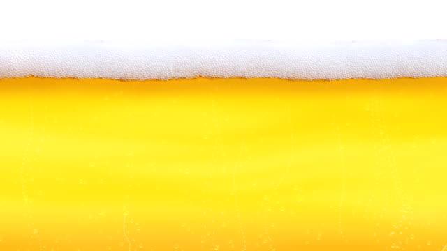 vídeos de stock e filmes b-roll de bolhas e espuma de cerveja ansa - bebida com espuma