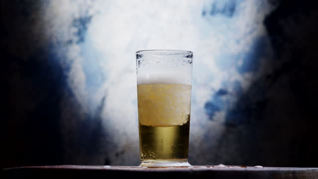 Beer in drinking glass full of ice video