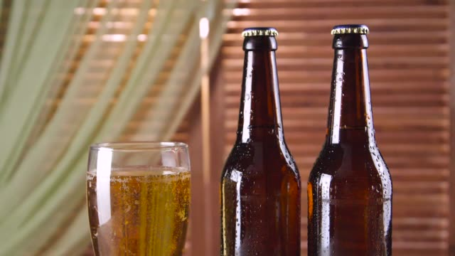 beer in glass and beer in bottles video