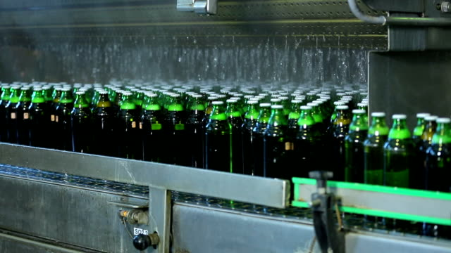 Beer or soda drinks factory. Production automated conveyor. video