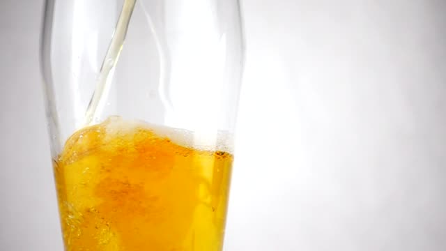 Beer poured into a beer glass in slow motion. Beer close up Beer close up. Beer poured into a beer glass in slow motion glass material stock videos & royalty-free footage