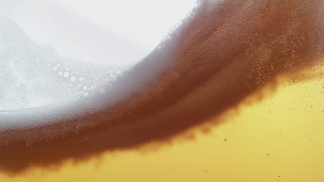 beer pouring and splashing in super slow motion. - birra video stock e b–roll
