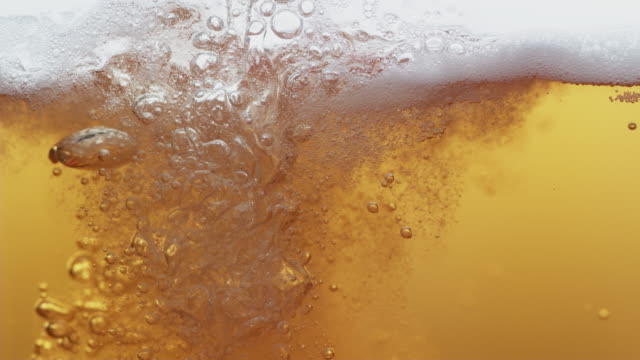 beer pouring in super slow motion. - birra video stock e b–roll