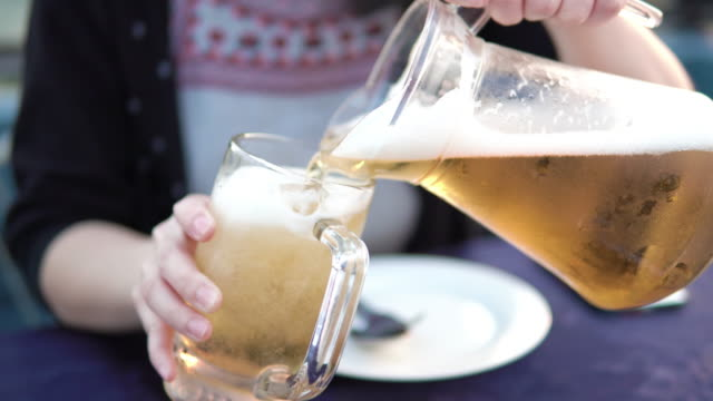 Beer pouring into a glass. Beer pouring into a glass. tonic water stock videos & royalty-free footage