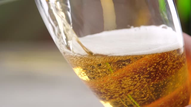 beer pouring into glass with bubbles
