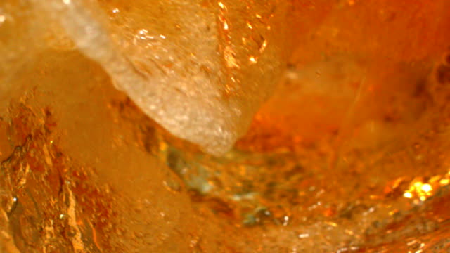 beer wave curve shape inside a glass in slow motion macro shot on phantom camera - birra video stock e b–roll