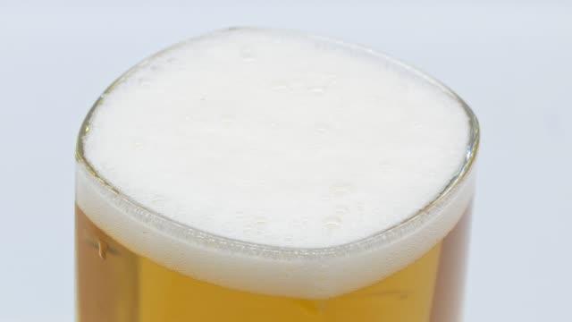 Beer white studio close up shot video