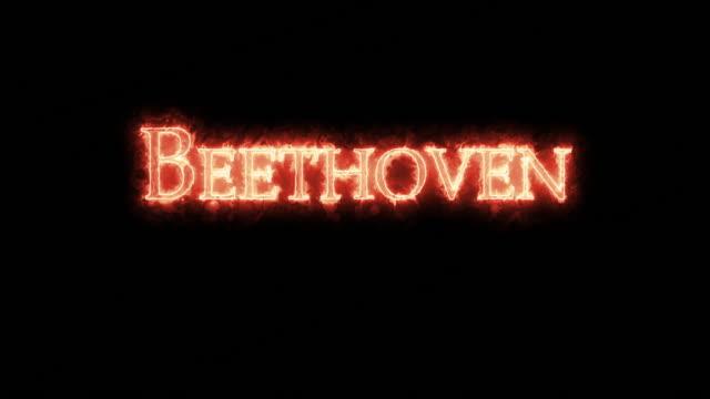 vídeos de stock e filmes b-roll de beethoven written with fire. loop - compositor
