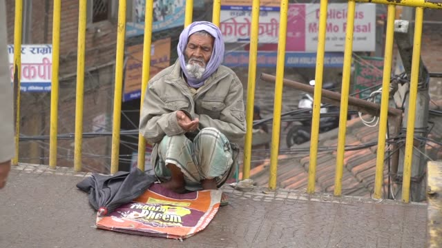 Beggar begs for money A homeless person asks for money from passersby. Nepal. Kathmandu homeless person stock videos & royalty-free footage