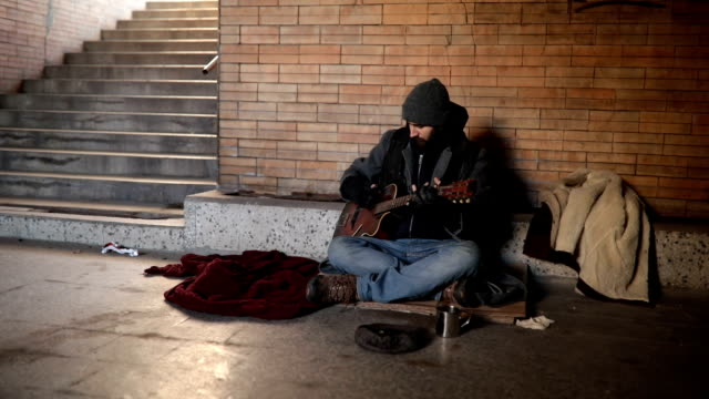 Beggar playing guitar on the street video