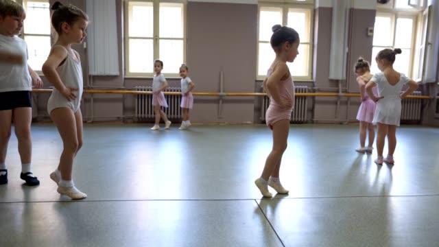 Beginner ballet dancers doing basic exercises Playful little ballet dancers dance studio stock videos & royalty-free footage