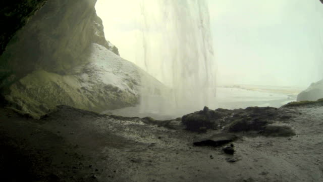 Behind the waterfall Seljalandsfoss in Iceland video