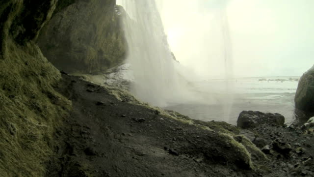 Behind the waterfall Seljalandsfoss in Iceland, wintertime video