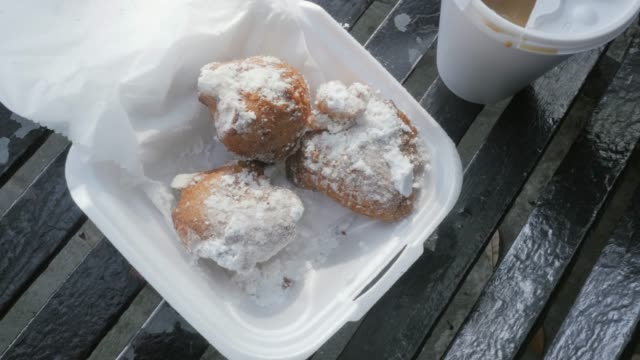 Beignets and Cafe au Lait on a Park Bench in the French Quarter, New Orleans video