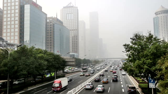 Beijing, China-Oct 25, 2014: In the bad weather,the buidings in Guomao CBD are hazy at a distance, Beijing,China video