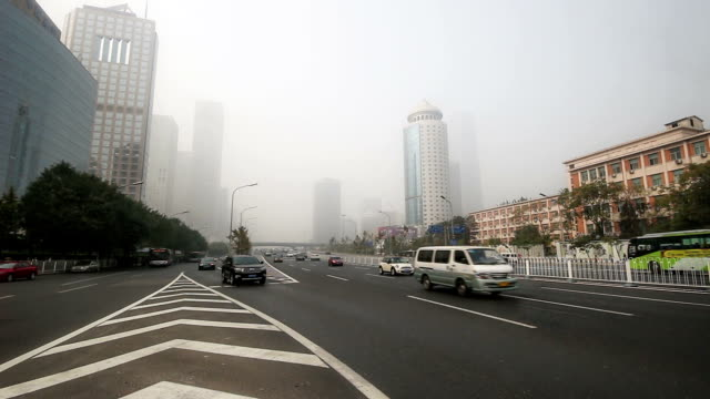 Beijing, China-Oct 25, 2014: In the bad weather,the landmark of Guomao CBD are hazy at a distance, Beijing,China video