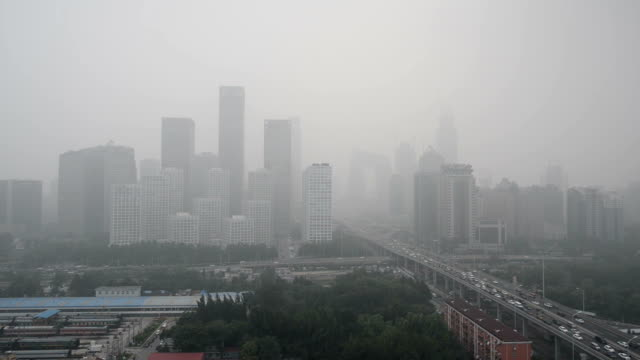 beijing smog, beijing urban skyline in air pollution - smog video stock e b–roll