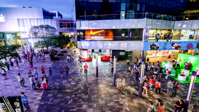 Beijing,China-Aug 13,2014: Fashion of young people wander the Sanlitun Village shopping center in Beijing, China video