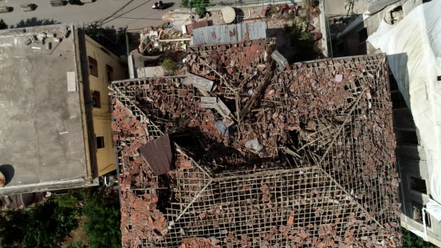 Beirut explosion left hundreds of damaged buildings drone shot tracking down towards the roof of a damaged old house. beirut stock videos & royalty-free footage
