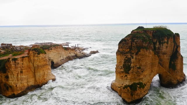 Beirut's Natural Landmark - The Pigeons' Rock / The Rock of Raouché Nature, Ocean, Seascape, Lebanon, Middle East - 4k Footage of Seascape around Pigeons' Rock in Beirut Lebanon beirut stock videos & royalty-free footage