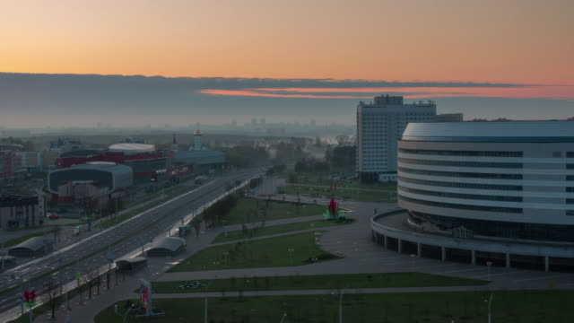 belarus sunset minsk arena area roof top panorama 4k time lapse - беларусь стоковые видео и кадры b-roll