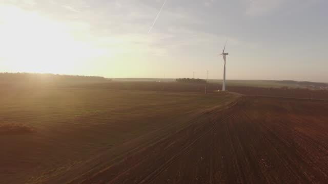 belarus sunset sky sun light windmill in the spaceless field aerial panorama 4k video