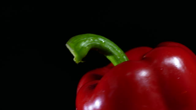 Bell pepper turning on black background video