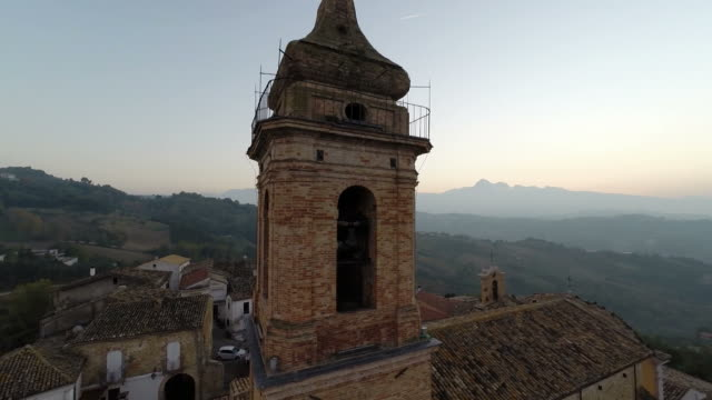 bell tower at sunset with mountains video