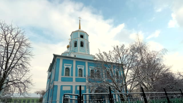 4K Bell tower of the Orthodox Church against the blue sky. Smolensk Cathedral, Belgorod, Russia video