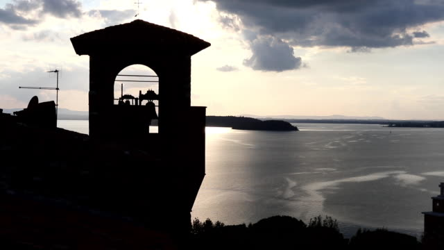 Bell tower - sunset over lake