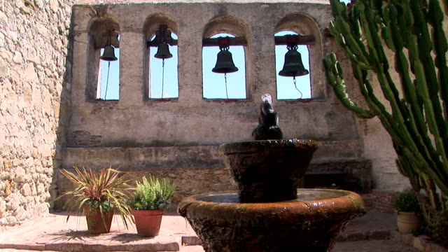 Bell Wall and Fountain Water fountain and historic bells of San Juan Capistrano church architecture stock videos & royalty-free footage