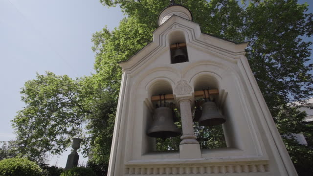Bells in orthodox church or chapel in crimea, russia. cinemaic ancient religious symbol