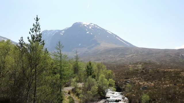 ben nevis scotland uk with snow topped mountains in summer with mountain stream - fort william video stock e b–roll