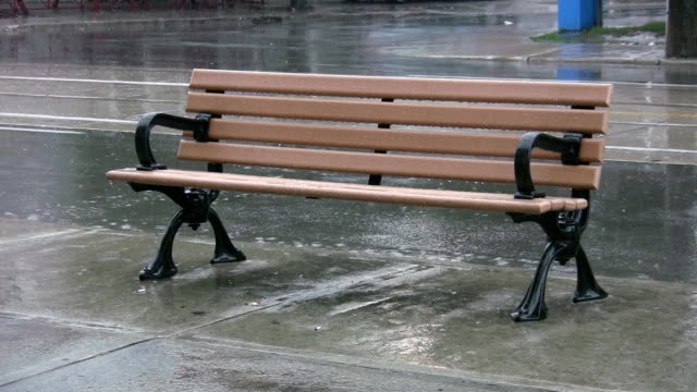 Bench in the rain. video