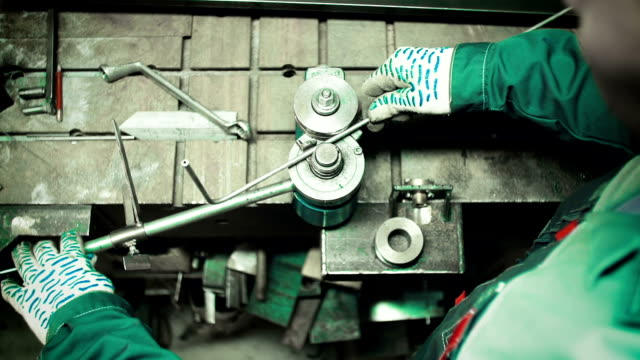 bending the pipes in the factory. pipe bending machine - inarcare la schiena video stock e b–roll